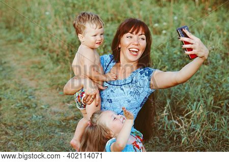 Mom Takes Photos Of Herself With Children On Her Phone