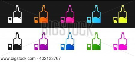 Set Tequila Bottle And Shot Glass Icon Isolated On Black And White Background. Mexican Alcohol Drink