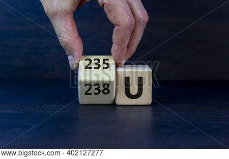Uranium Enrichment Symbol. Hand Turns The Cube And Changes The Word '238 U' To '235 U'. Beautiful Da
