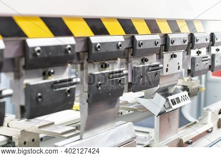 Close Up Teeth Of The Semi Automatic Hydraulic Bending Machine And The Metal Sheet Or The Workpiece