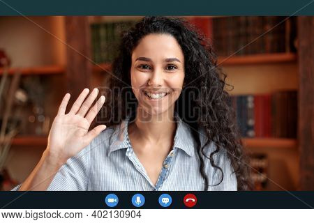 Head Shot Of Smiling Young Female Employee Worker Waving Hand To Webcam, Greeting Colleagues At Remo