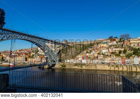 Porto, Portugal - December 26, 2020: the famous houses of the Ribeira in the Douro River bank near the Dom Luis I Bridge, Porto, Portugal.