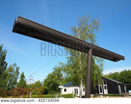 Modern Trendy Design Innovative Folding Pergola Arbor Made Of Metal With Clear Blue Sky Background