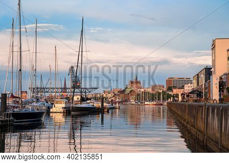 Rostock, Germany - July 15, 2020: Evening View Of Rostock Skyline From Warnow River