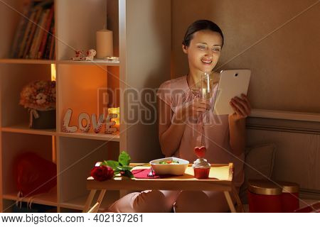 The Girl Communicates Via Video Link With Her Beloved And Makes A Toast With A Glass Of Champagne In