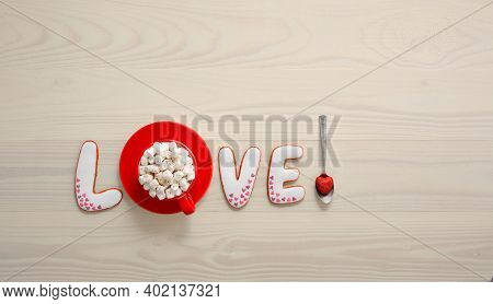 Cute Gingerbread Lettering With Heart Decoration And Bright Red Cup With Marshmallows For Valentine'