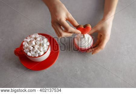 A Someone In Love Prepares Cupcakes For A Loved One For Valentine's Day, Decorating The Dessert With