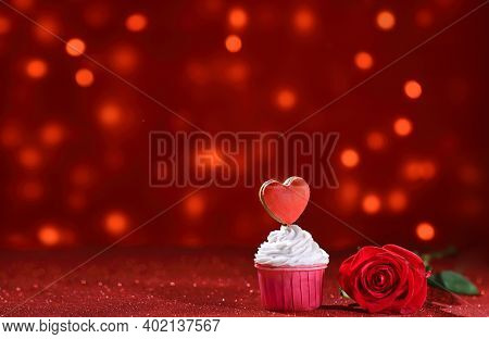Bright Red Heart On The Muffin Top For Valentine's Day With Rose Flower Like A Sweet Declaration Of