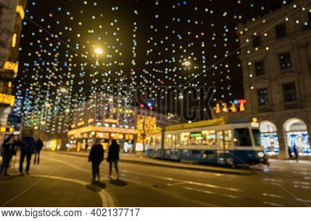 Abstract Blurred Christmas Lights Called Lucy At Illuminated Paradeplatz In Zurich. Millions Of Hang