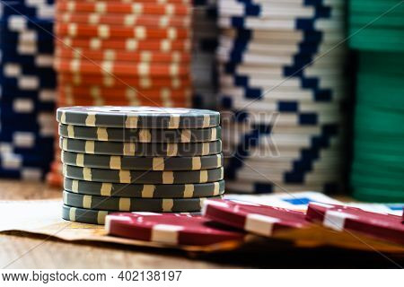 Poker Casino Chips And Money Close Up. Casino Concept, Risk, Chance, Good Luck Or Gambling. Detail O