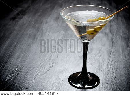 Drink Martini. Martini With Olives On A Black Table. Free Space For Text.