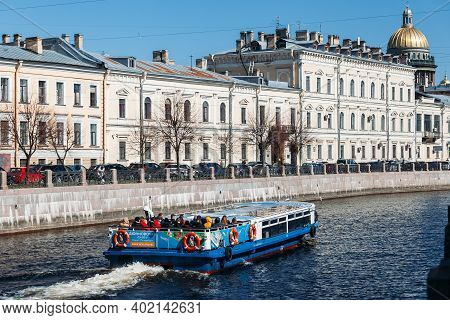 Saint Petersburg, Russia, 18.04.2019, River Boat With Tourists Floating On Moika Rive In St. Petersb
