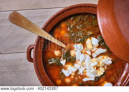 Earthenware Casserole With Spinach Chickpea And Hard-boiled Egg Stew
