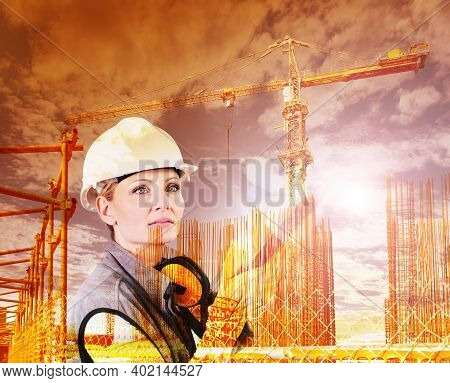 Woman Construction Worker On Building Site With Crane With Safety Hard Hat And Hearing Protection He