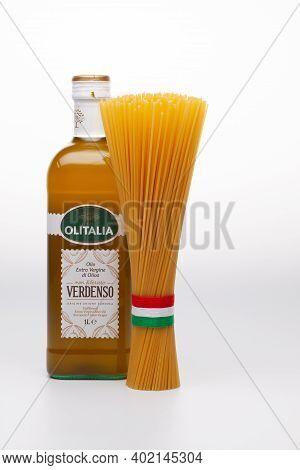 Prague,czech Republic - 10 December ,2020: Bottle Of Verdenso Olive Oil And Spaghetti On The White B