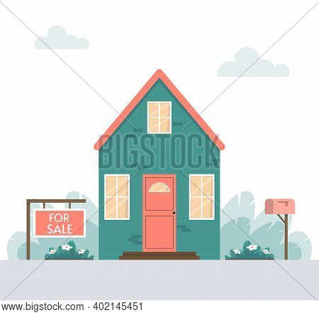 House For Sale.  Sign With Information In The Foreground. Facade Of A House With Plants And A Mailbo