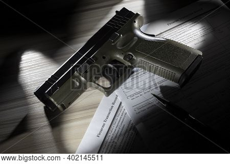 Pistol And Pen Resting On The Public Domain Fbi Forms Used To Do A Nics Background Check Before A Gu
