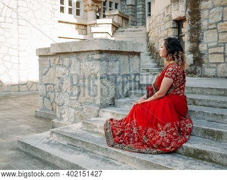 Beautiful Ethnic Indian Saree. Young Woman In Red, Colorful, Sensual, Wedding And Very Feminine Outf