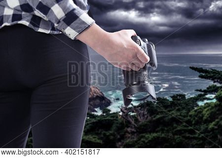 Female Photographer Or Tourist With A Photography Hobby Looking At The Ocean Landscape Of The Califo