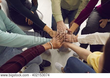 Multiracial People Putting Hands Together In Team Meeting Or Group Therapy Session
