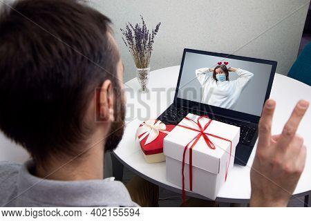 Couple In Love Having Virtual Date In Quarantine. Man Video Calling His Girlfriend During Lockdown A