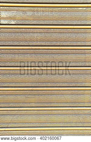 Corrugated Perforated Metal Sheet Surface With Perforations And Holes. Abstract Vertical Striped Bac