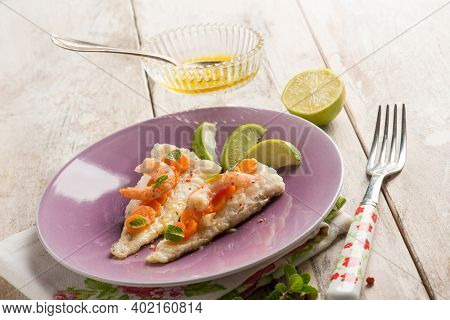 fish fillet with shrimp pink pepper carrots and lime