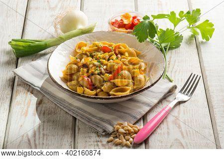 shelle pasta with tofu capsicum turmeric and pine nut