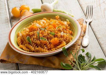 lentils pasta with yellow tomatoes and sage