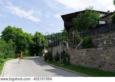 Teenager Blogger Visit And Traveling In Balkans Village Alone As Photographer Freelancer. Glamour So