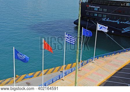 Port Of Piraeus, Athens, Attica, Greece - October 18, 2018:  Five Flags Flying On The Dock In The Ha