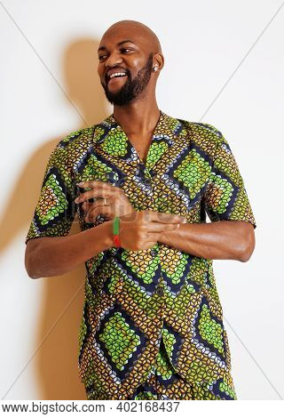 Portrait Of Young Handsome African Man Wearing Bright Green National Costume Smiling Gesturing, Ente