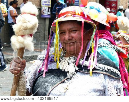 Cuenca, Ecuador - February 22, 2020: Carnival Parade In Cuenca City. Indigenous Woman With Wool Flee