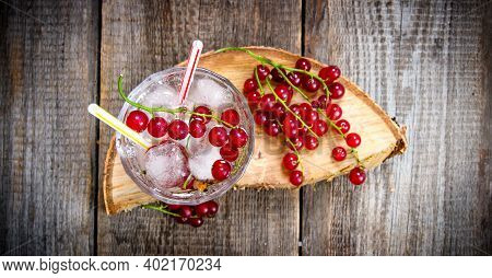 Cocktail Currants . A Cocktail Of Wild Currant With Ice On A Wooden Table. Top View
