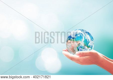 Sustainable Development Goals (sdgs) Concept: Human Hands Holding Earth Global Over Blurred Blue Wat