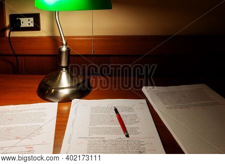Chiang Mai, Thailand- December 24, 2020: Proofreading Paper On Wooden Table Under Lamp Light At Nigh