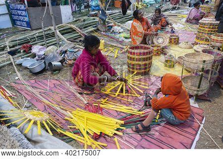 Kolkata, West Bengal, India - 31st December 2018 : Indian Female Artist Weaving Wicker Basket Handic