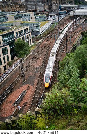 Edinburgh, United Kingdom - August 23 2020: LNER Azuma train leaving Edinburgh Waverly station