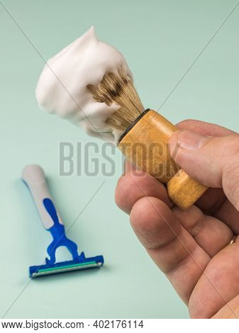 Shaving Brush With Shaving Foam On The Background Of A Disposable Razor. Set For Care Of A Man's Fac