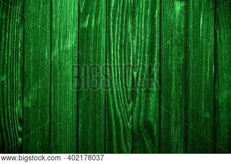Close-up Old Green Wooden Fence With Copy Space. A Wall Of Frayed Wooden Planks. Texture Of Old Pain