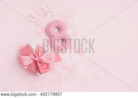 Number 8 And Gift Box As A Symbol Of The Holiday. Pink Monochrome Concept, Greeting Card For 8 March