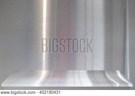 Empty Stainless Steel Shelf On Background Of Stainless  For Montage Or Present Product.