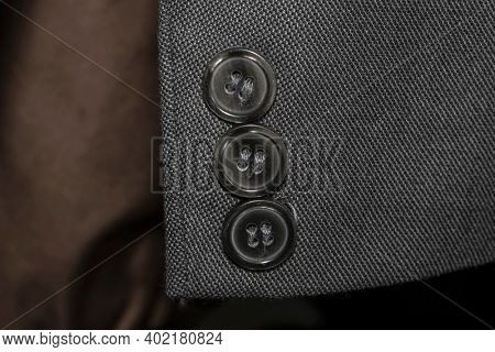 Close up shot of buttons on a blazer