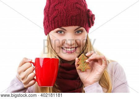 Smiling Woman Wearing Woolen Cap And Shawl, Holding Gingerbread Or Festive Cookies And Red Cup Of Ho