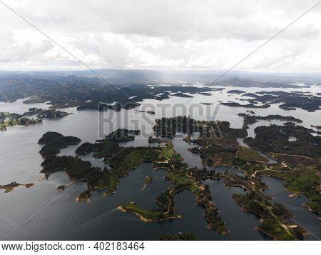 Aerial Panorama Of Artifical Lake Water Reservoir Dam Embalse Penol Guatape At Penon Rock Monolith I