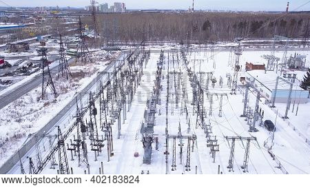 Rows Of Electric Poles Of Substation. Action. Top View Of Small Electrical Substation With Rows Of T