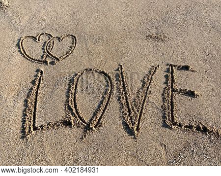 valentines, two hearts on the beach. two hearts drawn on perfectly white sand of paradise beach