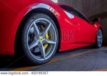 Bangkok, Thailand - 06 Jan 2021 : Close-up Of Wheel Of Red Ferrari Sports Car.  Ferrari Is Italian S