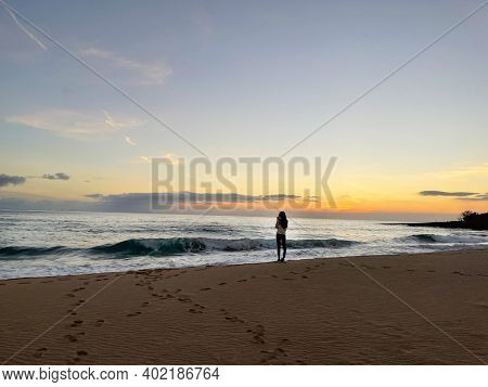 Traveler walking on tropical beach in vacation.