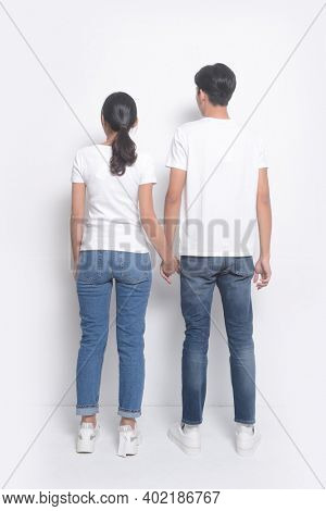Loving couple posing on a white background.  romantic couples in love meet,back view
